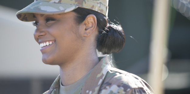 Female Soldier wearing U.S. Army uniform and demonstrating proper grooming requirements.