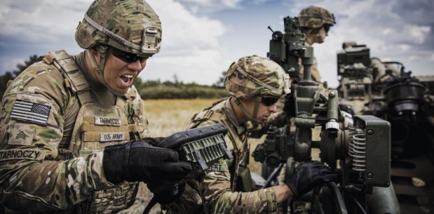 Soldiers wearing OCP and helmets taking part in Field Training.