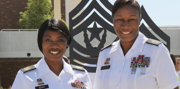 Soldiers standing in front of the Command Sergeant Major Academy.