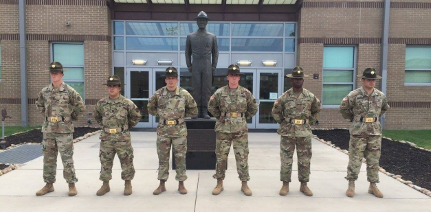 U.S. Army Drill Sergeants standing in front of the U.S. Army Drill Sergeant Academy.