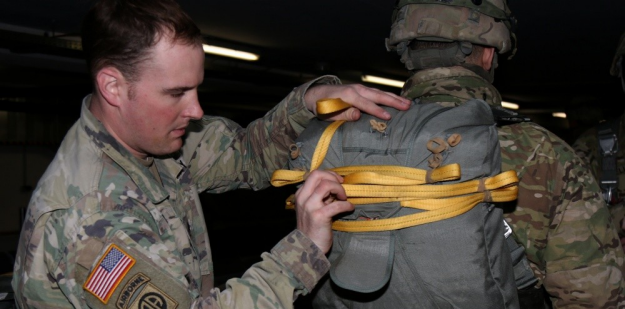 U.S. Army Jumpmaster inspecting a parachute.