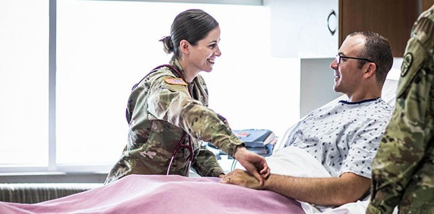 Soldier examining a patient.