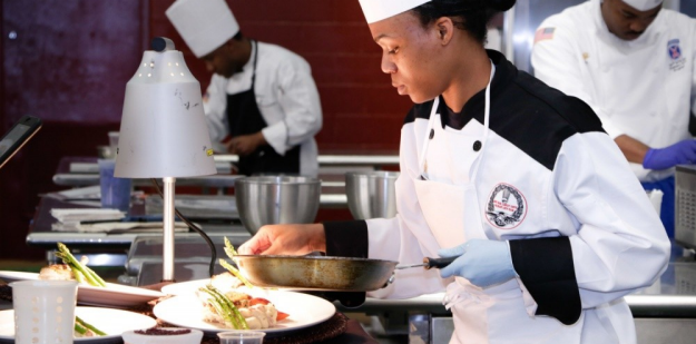 Army chef preparing food for Basic Training
