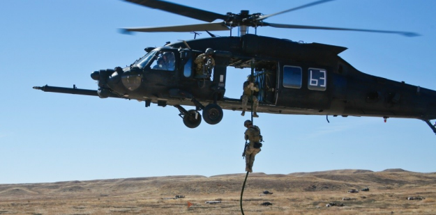 Soldiers rappel from Black hawk during training mission.