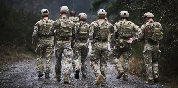 Special Forces Soldiers patrol a sector